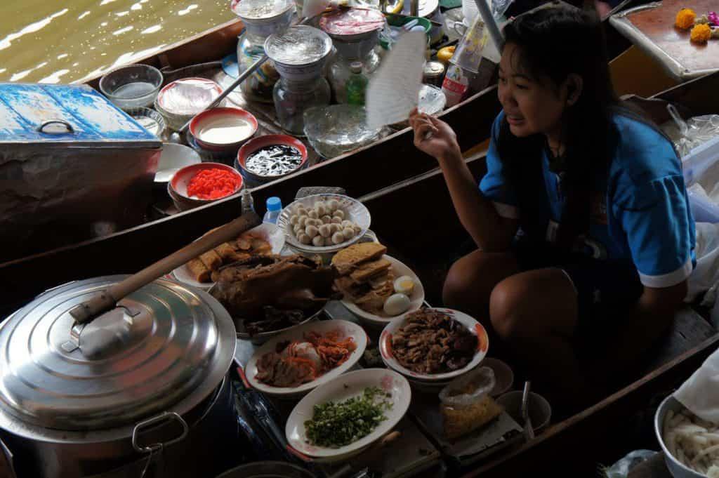 Thai girl selling some Thai food