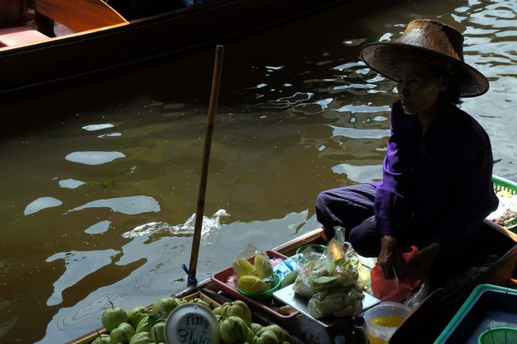 Thai woman selling some fruits