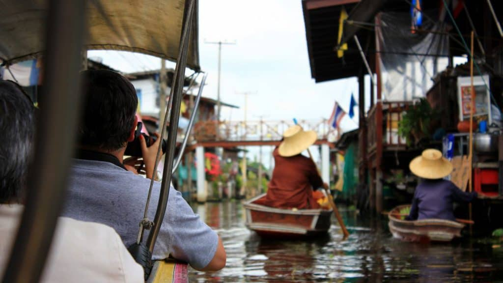 Thai people riding a boat