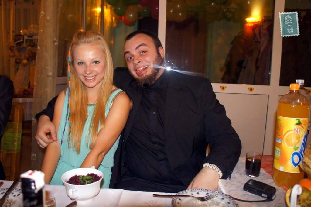 Two people are smiling at a Polish wedding