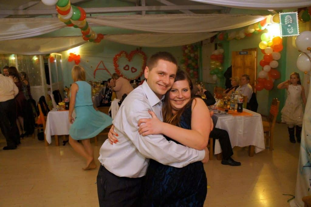 Two people are dancing and smiling