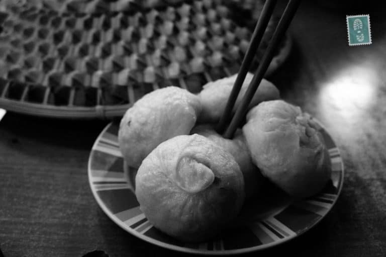 A plate of Chinese baozi and a hat