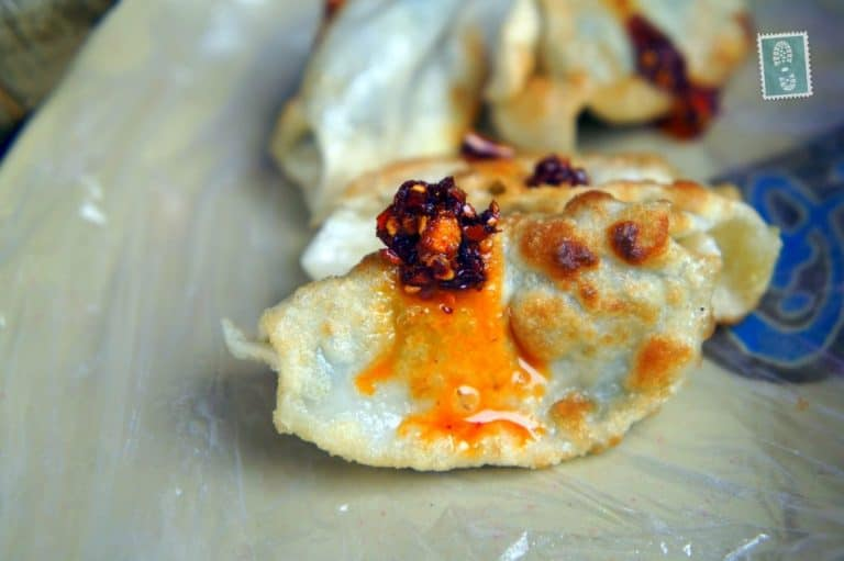 Fried Jiaozi with some spicy chili oil sauce, yummy!
