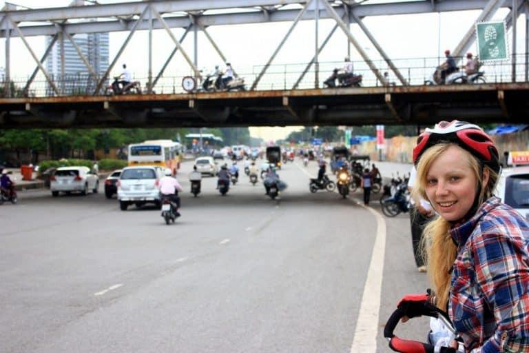 Traffic jam in Hanoi a girl on a bike