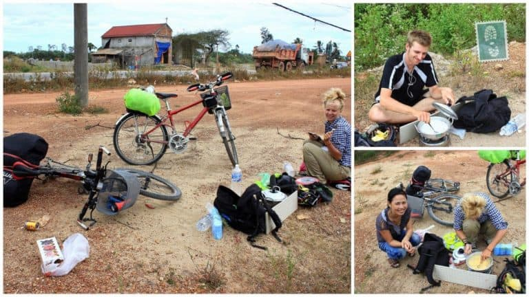 Three people are cooking on the road with bike in Vietnam