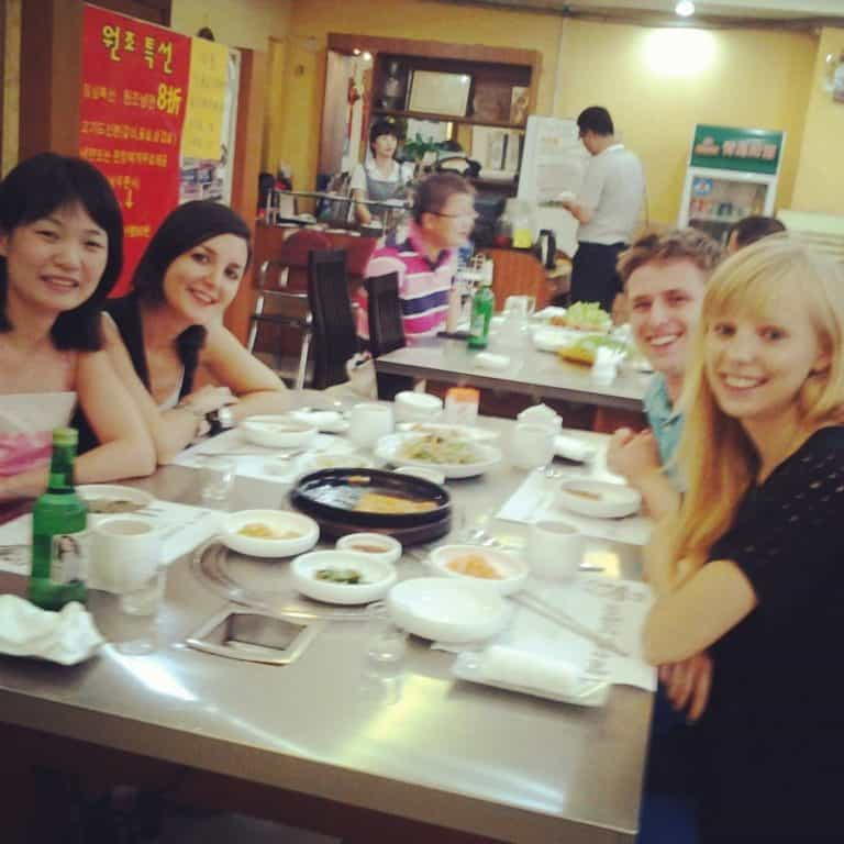 4 people are enjoying a Korean food