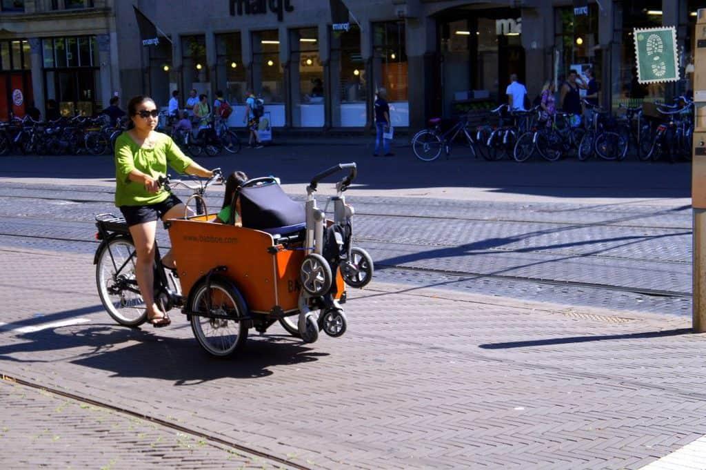 A woman riding a bike in Hague
