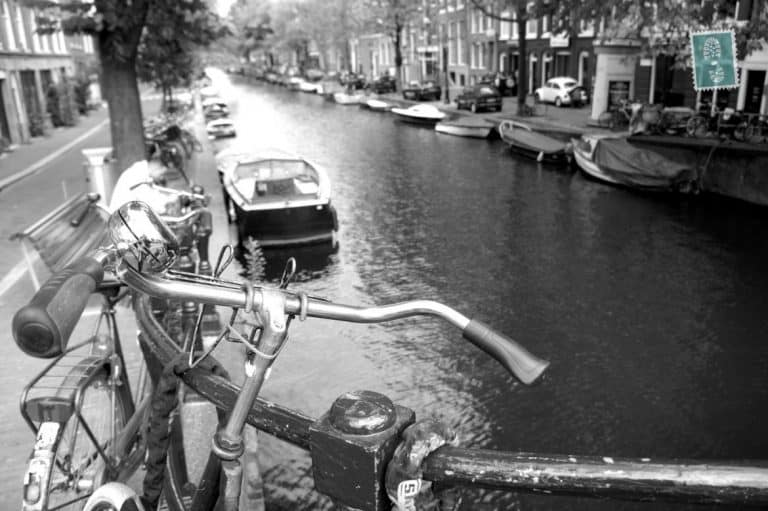 Tourist boats ply their trade on the numerous canals that criss-cross the historical centre of Amsterdam