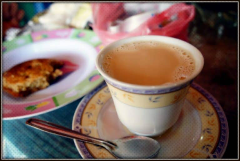 Sri Lankan breakfast A cup of sweet milky tea and a piece of cake