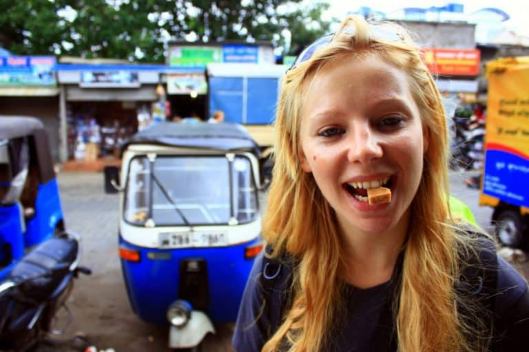 A girl is eating candies in Sri Lanka