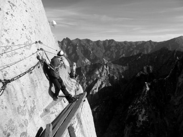 A guy climbing mountains