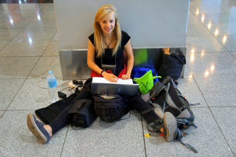 A girl sitting on the ground at Cebu Airport