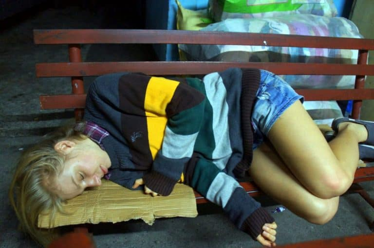 Agness sleeping on a bench