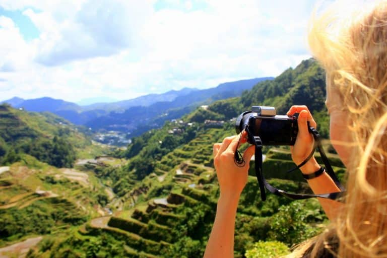 Agness is taking a picture of Banaue Rice Terraces