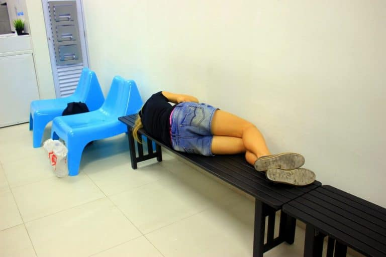 A girl Sleeping at laundry store in Singapore