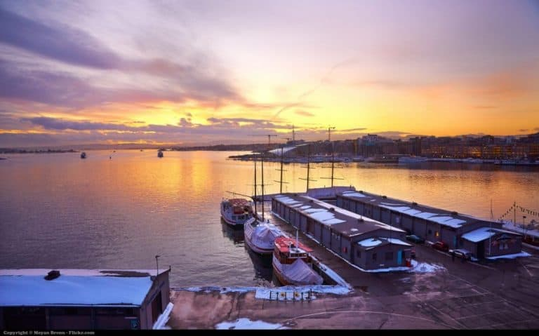 Oslo at sunset, panoramic view from the external area of the castle fortress next to the harbour. Picture credit: Moyan Brenn.