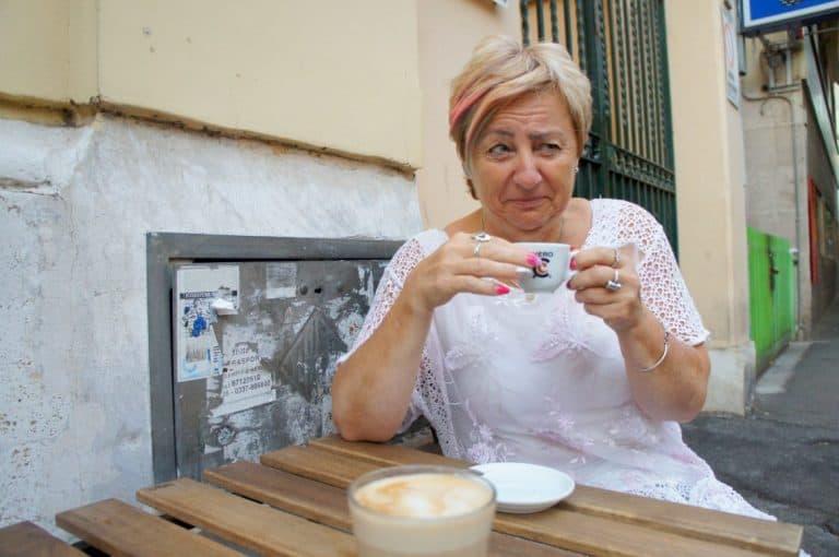 Woman tasting Caffé Corretto