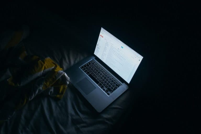 Working with a laptop on a bed