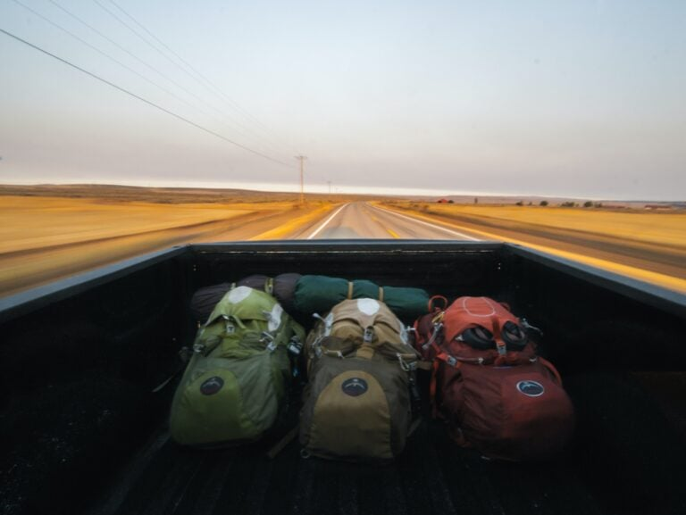 three travel backpacks on the road etramping